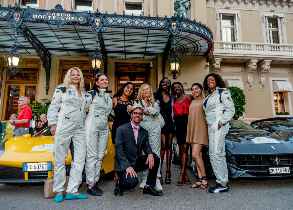 participants to the Prancing Ponies Rally and Leadership Acceleration Academy in front of the Monte-Carlo Casino