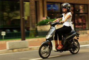 Serena Benedetti driving a Kosmob electric scooter